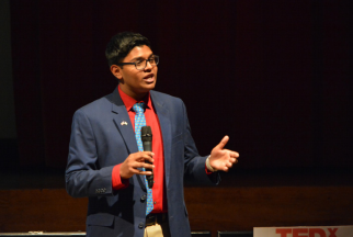 """""""What Now?""""-- Live speaker Shreyas Parab talks to the audience about his company My Novel Tie at the TEDxFarmingtonHighSchool event on November 19 in the auditorium. The event featured live and pre-recorded talks."""