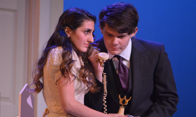 Destiny's call-- Junior Matt Plona (George Bailey) and senior Noor Taweh (Mary Hatch) get a phone call during the Thursday night performance of It's a Wonderful Life, the Drama Club's first ever holiday play. The pair led the play alongside junior Aaron Robair (Clarence) on December 1, 2 and 3.