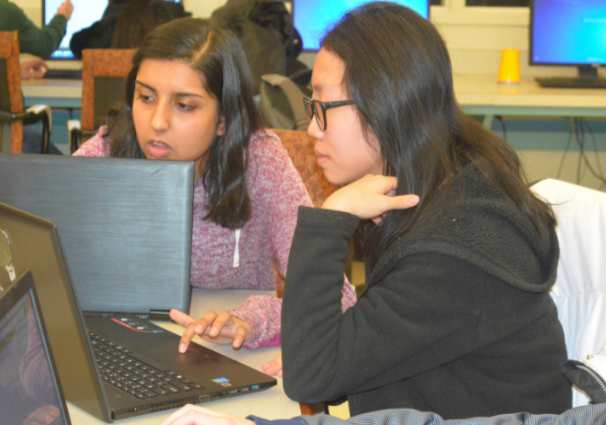 Code+problem--+Junior+Elizabeth+Cho+and+sophomore+Pooja+Swami+work+on+programming+a+robot+in+Java+for+this+year%E2%80%99s+FIRST+Robotics+Competition+during+a+Workshop+Wednesday+afer+school.+Cho+has+been+on+the+robotics+team+for+the+past+three+years+and+is+currently+one+of+the+two+Programming+Commit-+tee+Heads.+Her+main+focus+is+working+on+programming+the+robot+for+use+at+competitions.