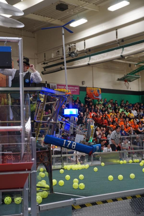 Ready for takeoff-- The Second Law Enforcer's robot climbs the rope during the last 30 seconds of their match. Robots in this year's game have the opportunity to earn up to 150 points per alliance team if they have the ability to climb.