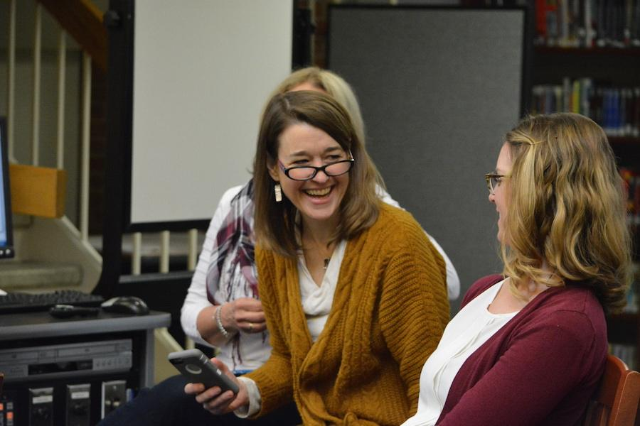Lots of laughs-- Department Leader for Library, Media and Technology K-12 Martha Burr laughs with English Department Leader Amy Miller during Paul Volponi's presentation. Volponi visited the high school on March 24, 2017 and held several presentations throughout the day and a writer's workshop during periods six and seven.