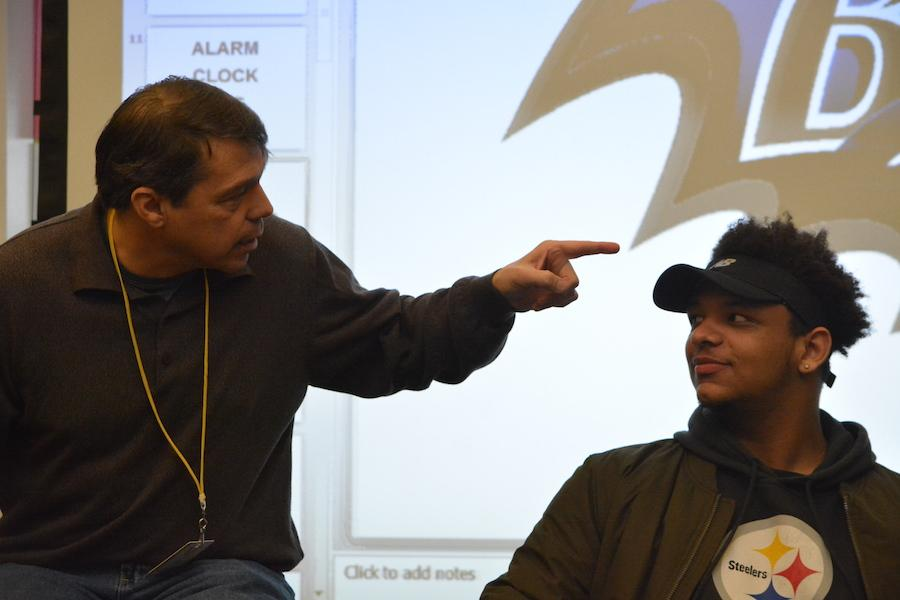 Volunteers+please--+Author+Paul+Volponi+asks+junior+Jermaine+Carter+about+his+Steelers+gear+during+one+of+his+presentation.+Students+found+Volponi%27s+March+24+presentation+to+be+fun+and+interactive.