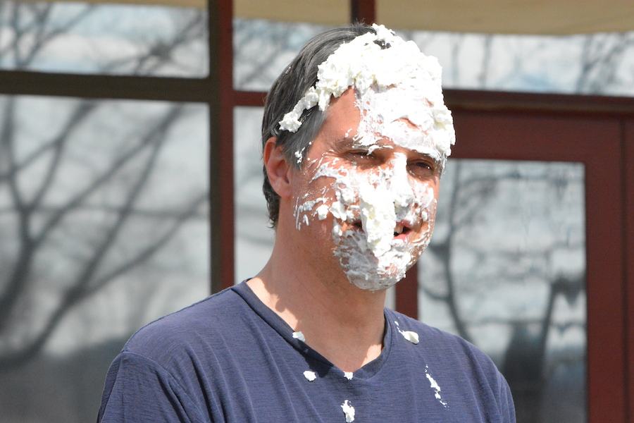 Food makes everyone happy-- Social studies teacher Jeff Gawle looks please after being pied in the face by junior Rita Monahan. Gawle was the winner of the UNICEF's Change Wars, a fundraiser organized to raise money for their cause. The teacher who accumulated the most money would be pied.