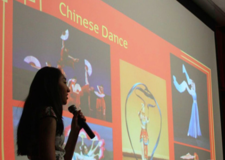 Talk it out-- Junior Caterina Wang speaks to students about traditional Chinese dance before demonstrating it. This presentation took place during the East Asia Day at Irving A. Robbins Middle School (IAR) to guide seventh graders with their research on East Asia.