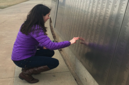 Remembering the past-- Junior Rachel Powell looks at the names of immigrants that passed through Ellis Island engraved in the memorial. Ellis Island served as one of two locations for which immigrants could pass into the United States.