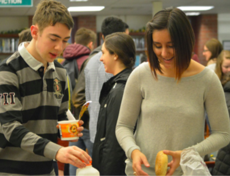 Bonjour -- French exchange student Simon Gleises (left) and senior Javiera Klenner (right) eat breakfast in the library as a welcome to the French students arrival from Caen. Farmington French students will be able to host French students again in 2019.
