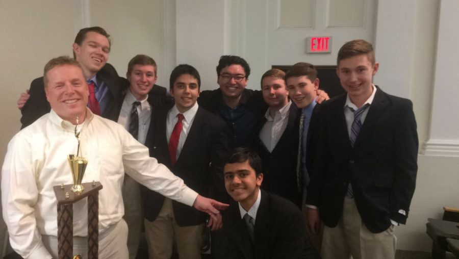 All+smiles--+The+Economics+Team+%28left+to+right%3A+coach+and+economics+teacher+Joel+Nick%2C+seniors+Erik+Weigmann%2C+Spencer+Buzdon%2C+Dylan+Suffredini%2C+Allen+Haugh%2C+Chris+Ware%2C+junior+Jay+Cohen+and+sophomore+Stewart+Buzdon%3B+floor%3A+junior+Sushane+Sharma%29+celebrates+after+their+win+at+the+12th+Annual+Harvard+Pre-Collegiate+Economic+Challenge+on+April+1.+Both+schools+beat+private+schools+in+the+semifinals%2C+with+Farmington+narrowly+besting+Phillips+Exeter+Academy%E2%80%99s+A+Team+in+a+sudden+death+tiebreaker+question+about+Risk+Aversion+Theory.