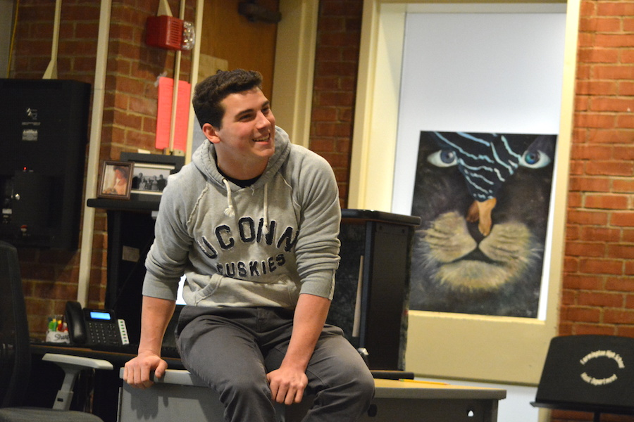 Presenting a Project-- Senior Alec Bohlman sits in front of a sophomore world history class as he presents his History Day project. The teachers had Bohlman present as an introduction into the Inquiry Project for the world history classes.