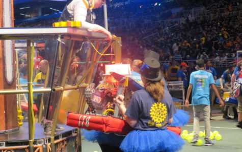Zooming around -- Team 178, The Second Law Enforcers, robot, Gearzmo, hits a hopper dropping 100 balls onto the field which can be collected and shot inside of a low and high goal. The team ranked an overall 35 out of 68 with seven wins and three losses after the three day event.
