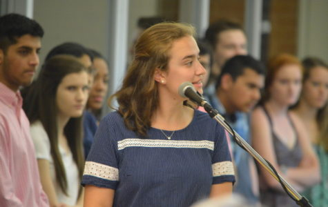 Natural leader-- Senior Math Honor Society (MHS) President Emma Sherrill presents during the MHS junior induction on May 18.  Sherrill was recently recognized as a Presidential Scholar semifinalist for her leadership both in and out of the school community.