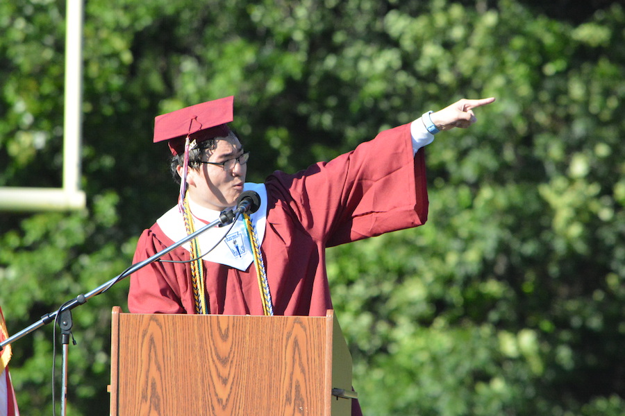 Getting+the+diploma--+Senior+Class+President+Allen+Haugh+speaks+to+his+classmates+during+the+graduation+ceremony.+The+graduation+ceremony+took+place+on+June+20+at+6+p.m.