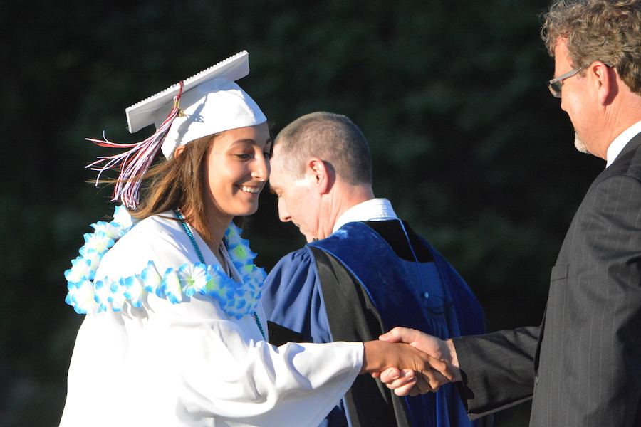 Getting+the+diploma--+Senior+Briana+Bermudez+accepts+her+diploma.+The+graduation+ceremony+took+place+at+June+20+at+6+p.m.