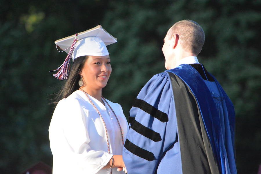 Getting+the+diploma--+Senior+Brittany+Chen+accepts+her+diploma.+The+graduation+ceremony+took+place+on+June+20+at+6+p.m.