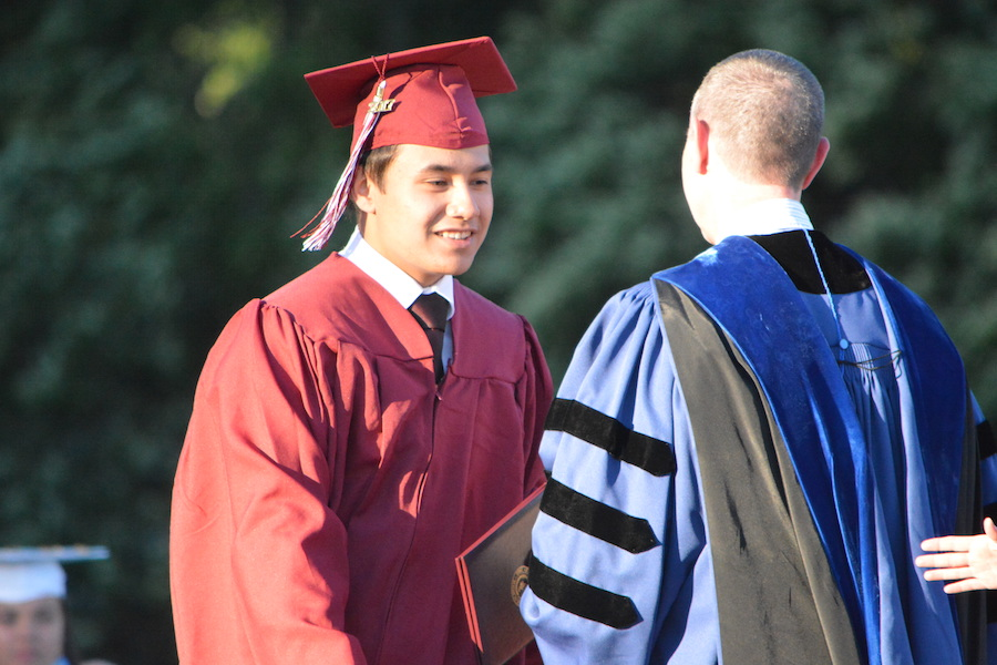 Getting+the+diploma--+Senior+Darren+Coates+accepts+his+diploma.+The+graduation+ceremony+took+place+on+June+20+at+6+p.m.