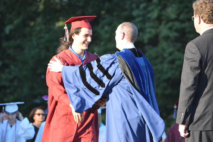 Getting+the+diploma--+Senior+Jake+Daugherty+accepts+his+diploma.+The+graduation+ceremony+took+place+on+June+20+at+6+p.m.