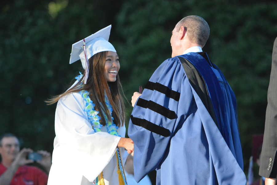 Getting+the+diploma--+Senior+Danielle+Gan+accepts+her+diploma.+The+graduation+ceremony+took+place+on+June+20+at+6+p.m.