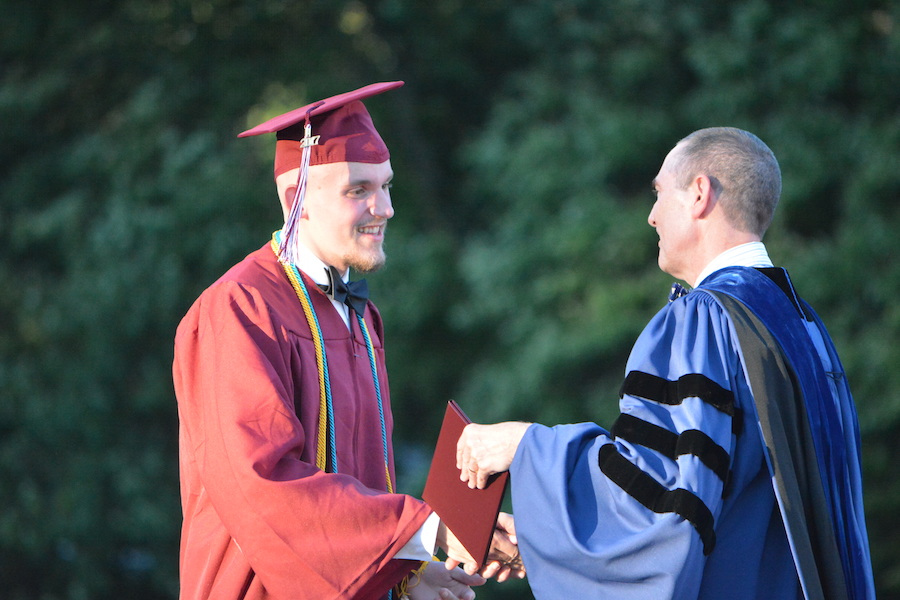 Getting+the+diploma--+Senior+Andrew+Leboeuf+accepts+his+diploma.+The+graduation+ceremony+took+place+on+June+20+at+6+p.m.