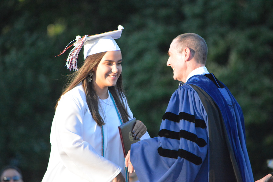 Getting+the+diploma--+Senior+Nichole+Maisto+accepts+her+diploma.+The+graduation+ceremony+took+place+on+June+20+at+6+p.m.