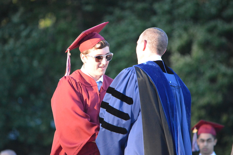 Getting+the+diploma--+Senior+Greg+Mancini+accepts+his+diploma.+The+graduation+ceremony+took+place+on+June+20+at+6+p.m.