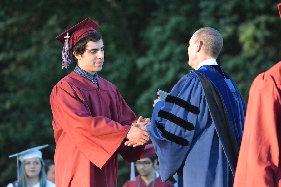 Getting+the+diploma--+Senior+Austin+Monde+accepts+his+diploma.+The+graduation+ceremony+took+place+on+June+20+at+6+p.m.