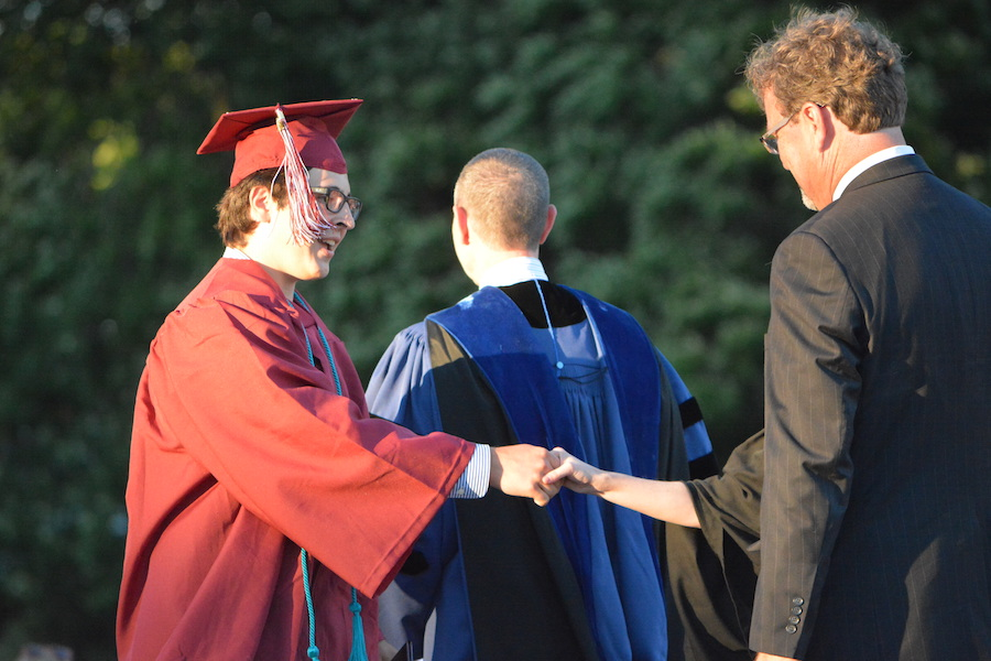 Getting+the+diploma--+Senior+Thomas+Peters+accepts+his+diploma.+The+graduation+ceremony+took+place+on+June+20+at+6+p.m.