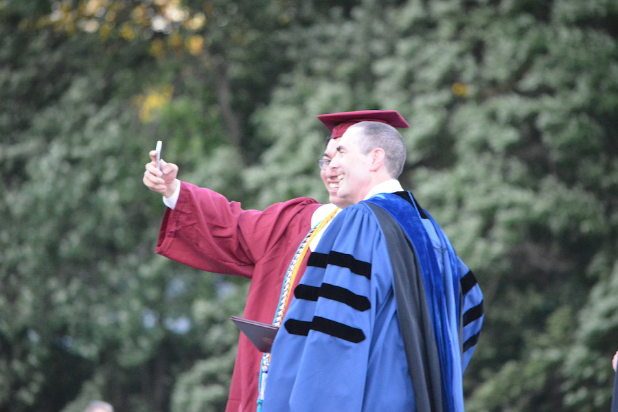 Getting+the+diploma--+Senior+Allen+Haugh+accepts+his+diploma+and+snaps+a+selfie+with+Principal+Bill+SIlva.+The+graduation+ceremony+took+place+on+June+20+at+6+p.m.
