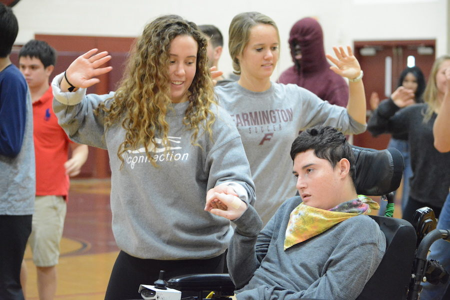 Dancing+together--+Senior+Amy+Driscoll+and+Unified+PE+partner+Gabby+Salas+practice+for+the+Dance+of+Kindness%2C+which+will+be+performed+by+students%2C+faculty%2C+and+staff+at+the+pep+rally+on+October+27.+The+Dance+of+Kindness+is+a+worldwide+event+hosted+by+Life+Vest+Inside+and+will+take+place+globally+on+November+13.
