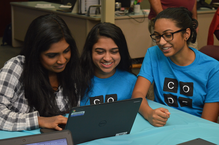 Juniors Shagun Prabhu (center) and Anushka Jami (right) help junior Reya Kalaiarasu (left) as she explores a programming activity. Hour of Code events took place at the high school on December 6 and will continue tomorrow, December 8.