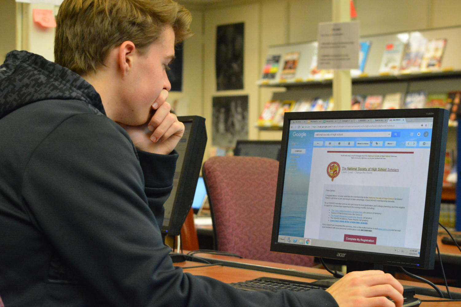 "Buyer beware-- Senior James Galske examines an email he received from NSHSS. According to Julia PItassy, Associate Director of Admissions at Trinity College, ""[the organization] is commonly viewed as a scam in the admissions world."""