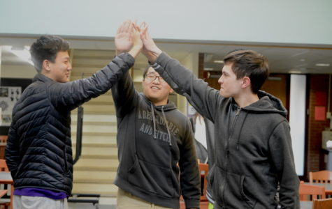 1,2,3 victory-- Juniors Ethan Grubelich, Huaxuan Chen, Brian Peng, and Nate Landry, celebrate their win on March 22 at the Trivia Night hosted by the World Awareness Programme club. Participants answered an overall 25 questions about various topics ranging from sports, history, geography and general information.