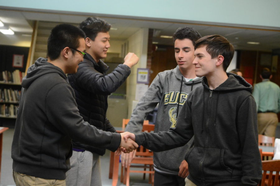1%2C2%2C3+victory--+Juniors+Ethan+Grubelich%2C+Huaxuan+Chen%2C+Brian+Peng%2C+and+Nate+Landry%2C+celebrate+their+win+on+March+22+at+the+Trivia+Night+hosted+by+the+World+Awareness+Programme+club.+Participants+answered+an+overall+25+questions+about+various+topics+ranging+from+sports%2C+history%2C+geography+and+general+information.