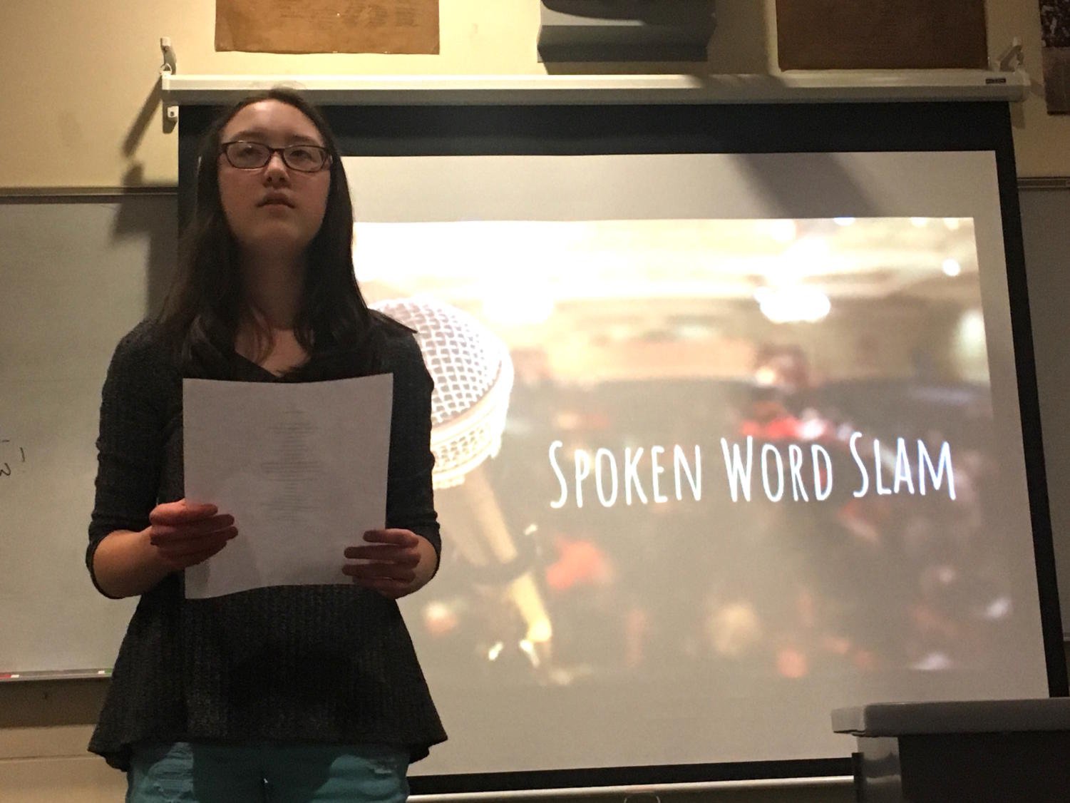 Clear and crisp-- Freshman Natalie Wong recites her original poem about her own identity. The poetry slam occurred after school on March 21 in room 701.