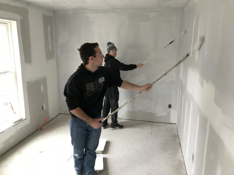 Painting+day+--+Seniors+Chis+Lagosz+%28left%29+and+Jack+Kowalczyk+%28right%29+prime+the+walls+of+a+house+with+the+staff+and+volunteer+members+of+Habitat+for+Humanity+in+East+Hartford+on+February+22.+A+total+of+nine+students+and+three+faculty+members+attended+the+field+trip+completing+various+tasks+such+as+cutting+and+drilling+drywall%2C+and+cleaning%2C+priming+and+painting+the+corners%2C+ceilings+and+walls+of+the+house.