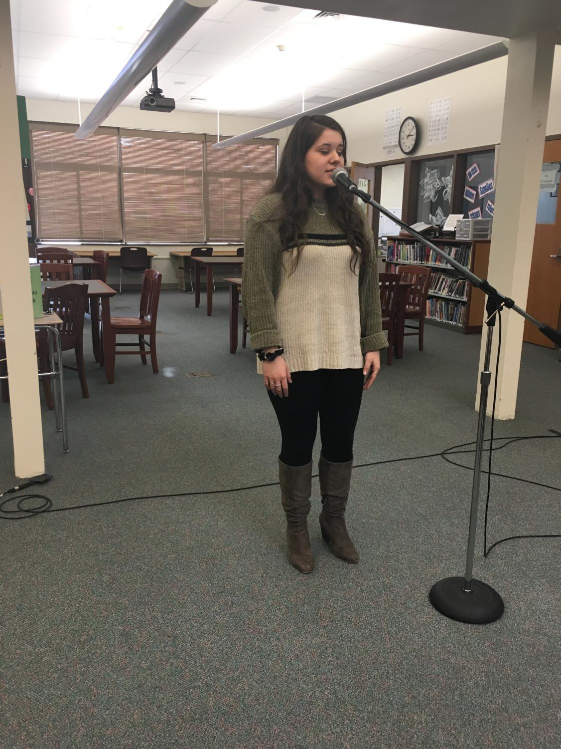 Mindful Monologue-- Senior Elena Jimenez-McDermott recites a passage from A Midsummer Night's Dream. The competition was held in the library on February 13.