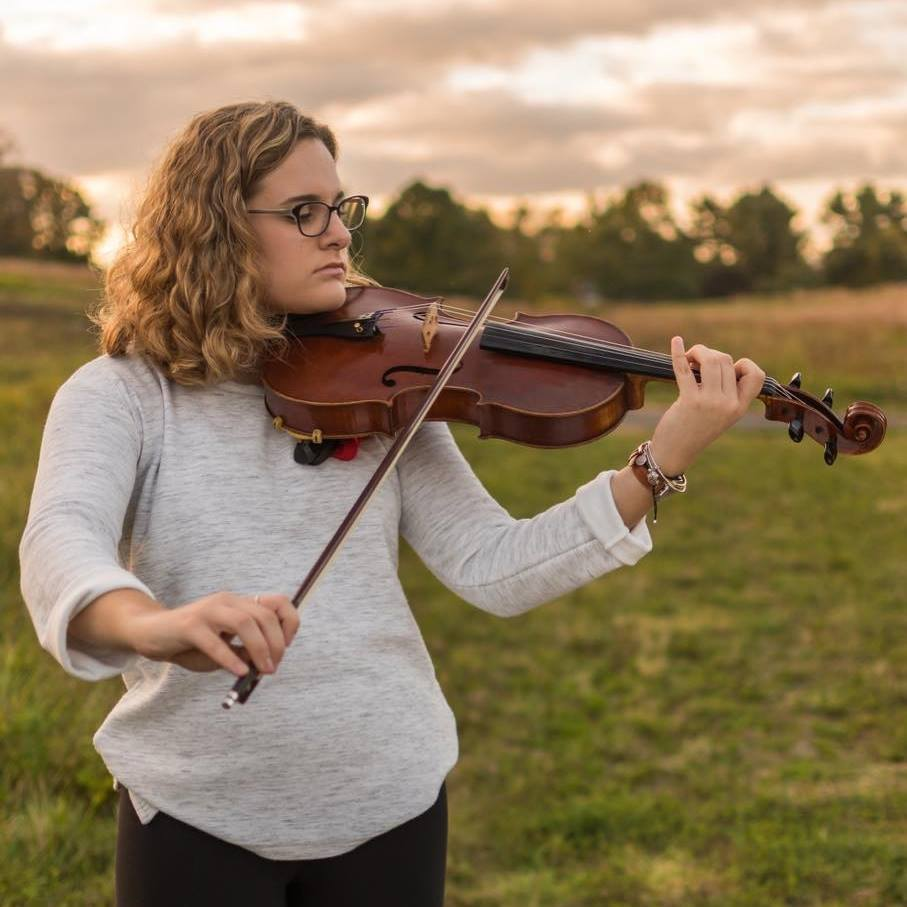 Vogler and her viola-- Senior Ashley Vogler plays her viola at Hillstead. She has been playing the viola the past three years in high school and has always had an inter- est in music. Vogler centered her capstone around the music business industry.