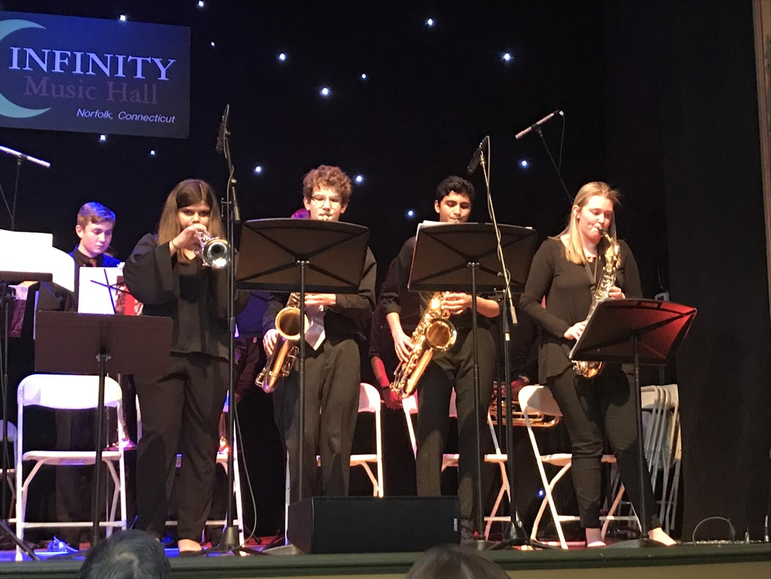 High notes-- Freshman Isabella Suffredini, sophomore Owen Tragash, junior Rohit Limaye, and junior Anna Saraceno play at the Southern New England High School Jazz Festival. The event, which took place at Infinity Hall in Norwalk, raised 350 dollars for the band.