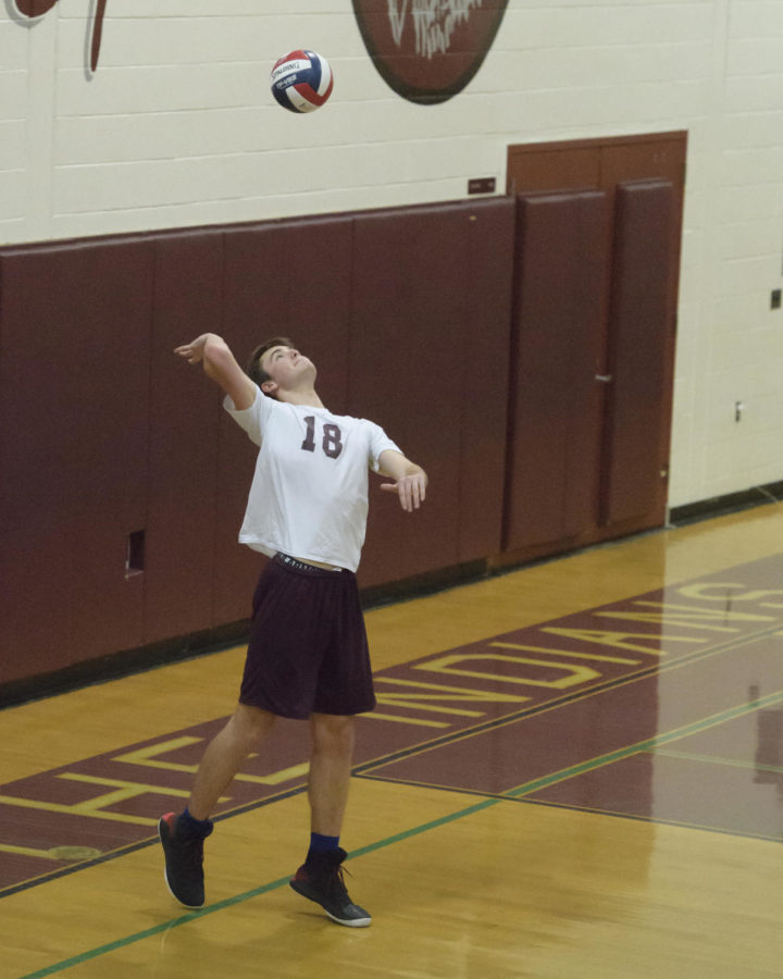 Serving+a+win--+Junior+Scott+Tuohy+serves+the+ball+during+a+recent+match.+Tuohy+is+a+middle+hitter%2C+and+has+been+playing+on+the+boys+volleyball+for+three+years.+%0A