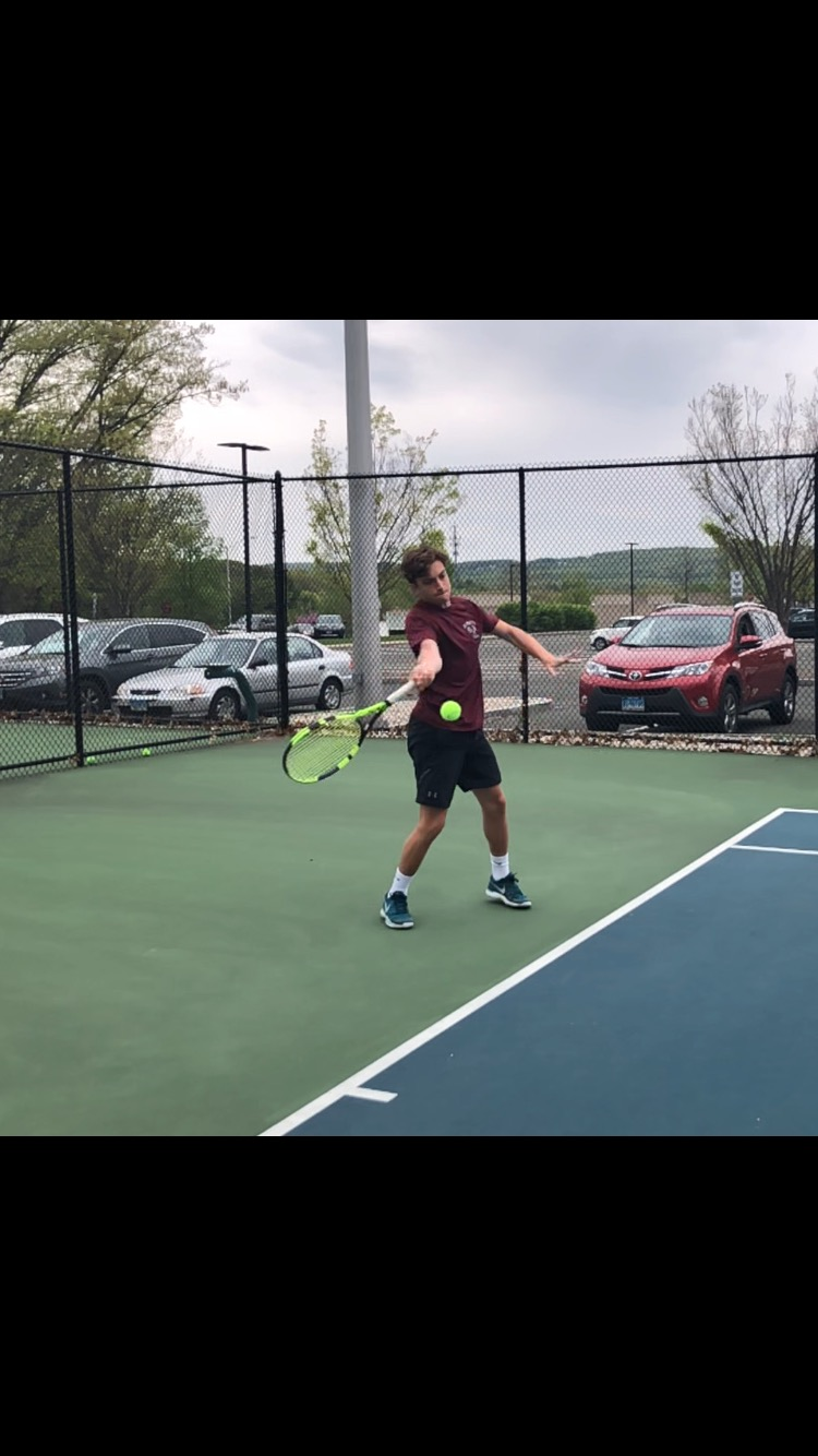Serve's up-- Senior Kam Moderessi returns a serve from teammate senior Blake Rutenberg in practice. The tennis team is 11-2 as of May 21 and fourth in Class L.