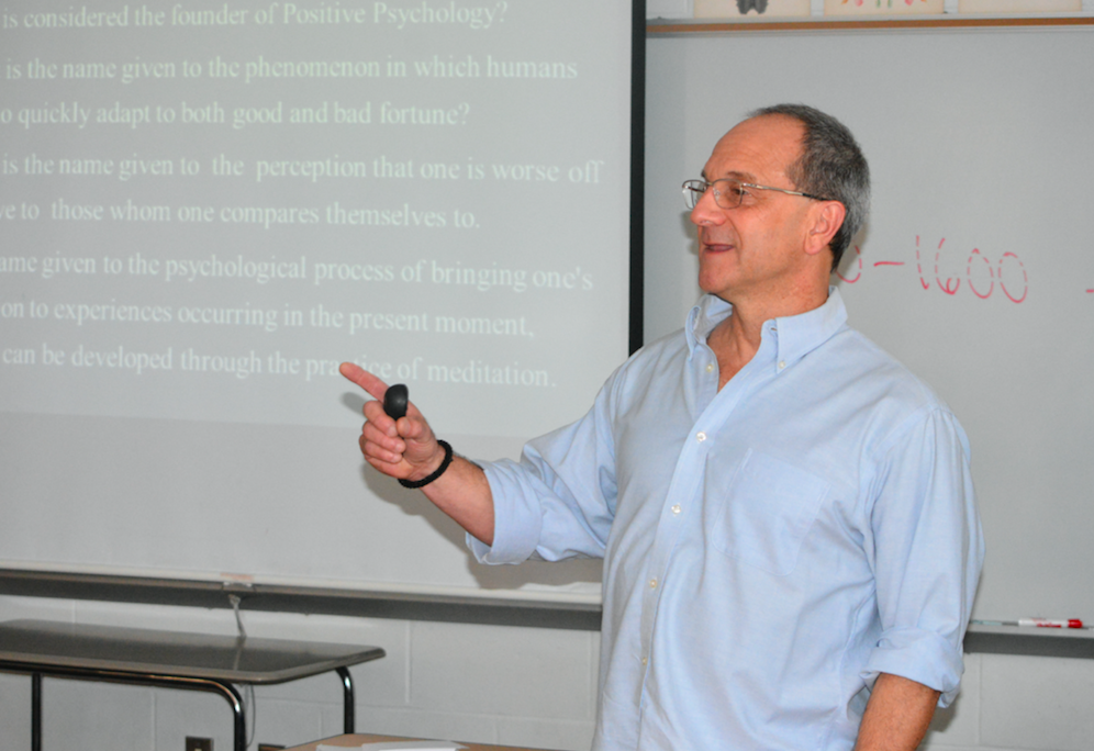 Serious about psychology -- Psychology and sociology teacher Mike Baxer teaches mindfulness to his first period Advanced Placement (AP) Psychology class. Baxer was voted as the senior class graduation speaker. Graduation will take place at 6 p.m. on June 15 on the high school turf field.