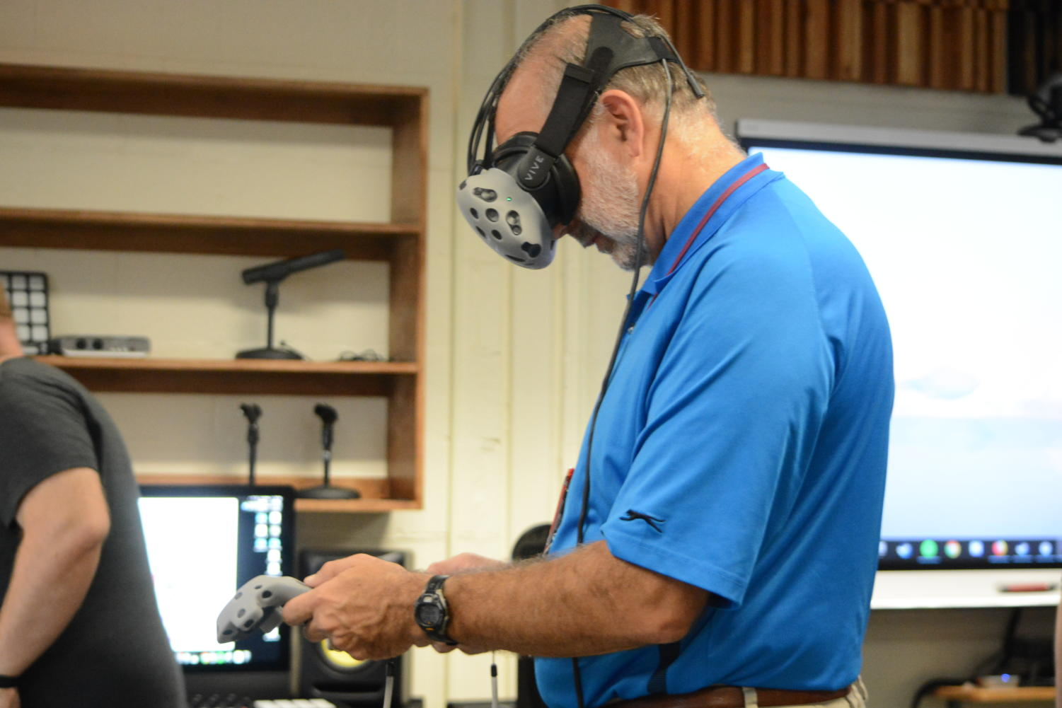 "High tech-- Math teacher John Kostal tries on the HTC Vive virtual reality headset at the ""Virtual and Augmented Reality in the Classroom"" workshop at Professional Learning Exchange (PLX). The event took place at the high school on Tuesday, October 9."