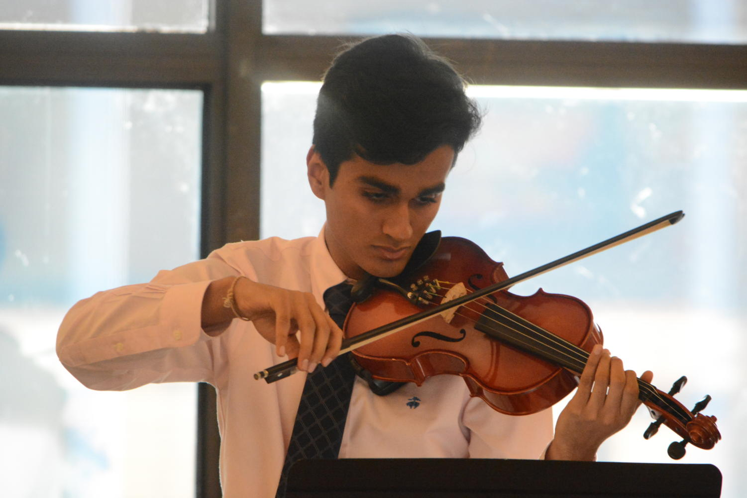 Virtuoso-- Senior Pranav Tavildar plays Czardas on the viola. Student musicians performed for local senior citizens at the Senior Cafe on Friday, October 19.