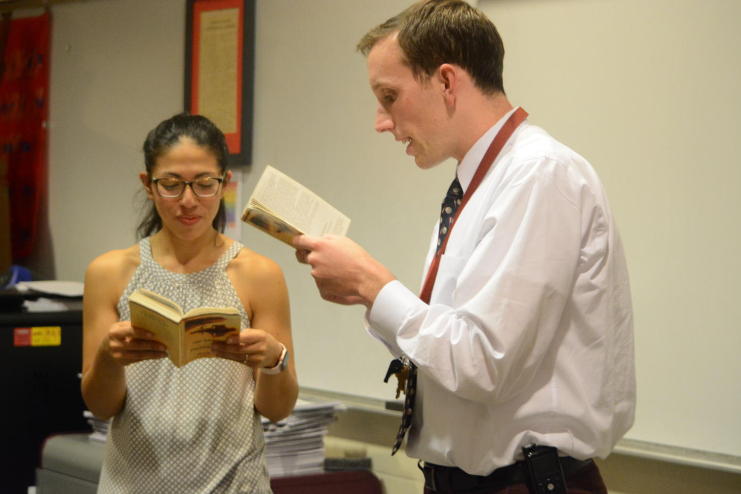 It takes two-- English teacher MJ Martinez (left) and social studies teacher Patrick Mulcahy (right) read The Adventures of Huckleberry Finn by Mark Twain together as part of third unit of the new American Studies Honors course. The course runs twice a day for two periods and fulfills both the English and United States History requirements for juniors.