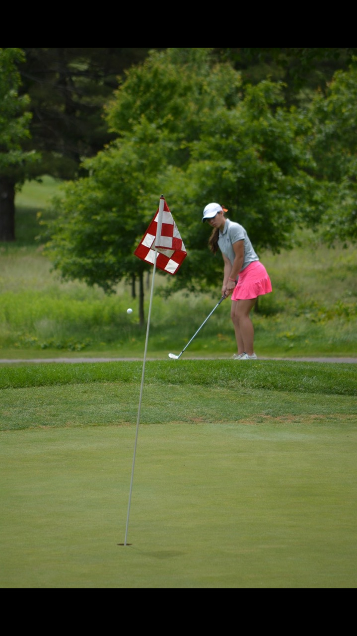 Tee up-- Senior Mia Grzywinski watches as the golf ball sails toward the hole. Gryzwinski has commited to play for Quinnipiac Univeristy's Division I golf program.