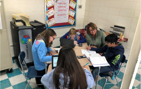 Master teacher-- Irving A. Robbins Middle School math teacher Amy Millar assists students in her class. Millar has taught at the middle school for 31 years.