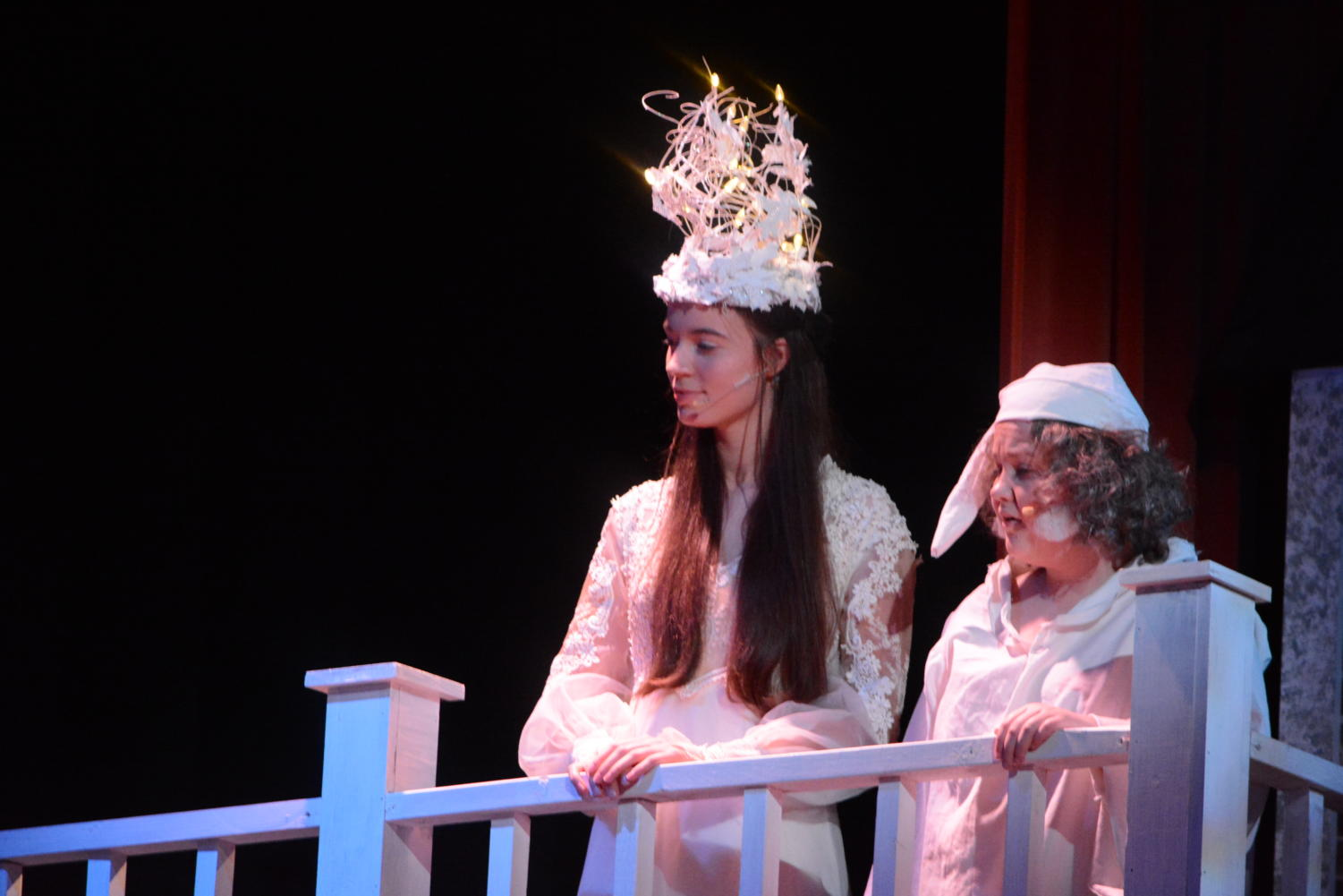 Blast from the past-- The Ghost of Christmas Past, played by junior Wiktoria Adamska (left), shows Ebenezer Scrooge, played by junior Audrey Lewis (right), a look back to the moment when young Scrooge, played by junior Evan Adams, abandons his fiancé, Belle, played by junior Jessie Clark. Applied arts teacher Jim Corrigan's classes built The Ghost of Christmas Past's headdress.
