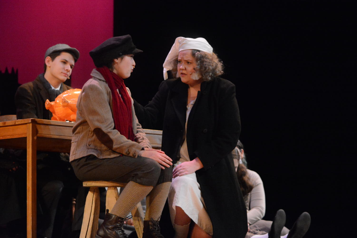 Redemption--+Ebenezer+Scrooge%2C+played+by+junior+Audrey+Lewis+%28right%29%2C+fawns+over+the+sickly+Tiny+Tim+Cratchit%2C%0Aplayed+by+sophomore+Sophie+Currier+%28left%29%2C+as+Bob+Cratchit%2C+played+by+senior+Tim+Scalzo+%28back%29%2C+looks+on.+Lewis%2C%0Awho+had+been+originally+casted+as+Mrs.+Cratchit%2C+took+on+the+role+of+Scrooge+around+a+month+prior+to+the+opening%0Aperformance.