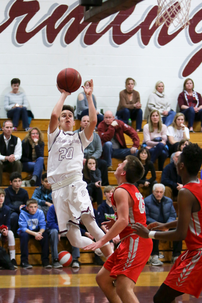 Jumping into the season-- Junior point guard Grayson Herr goes up for the shot during the team's game against Conard last year. The home opener will take place on December 15 versus Buckley.
