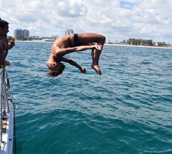 Flipping into a new season -- Junior diver Jadyin Calin flips into the water during last years swim and dive trip to Florida. This upcoming season, Calin hopes to set new personal and school records for his diving.