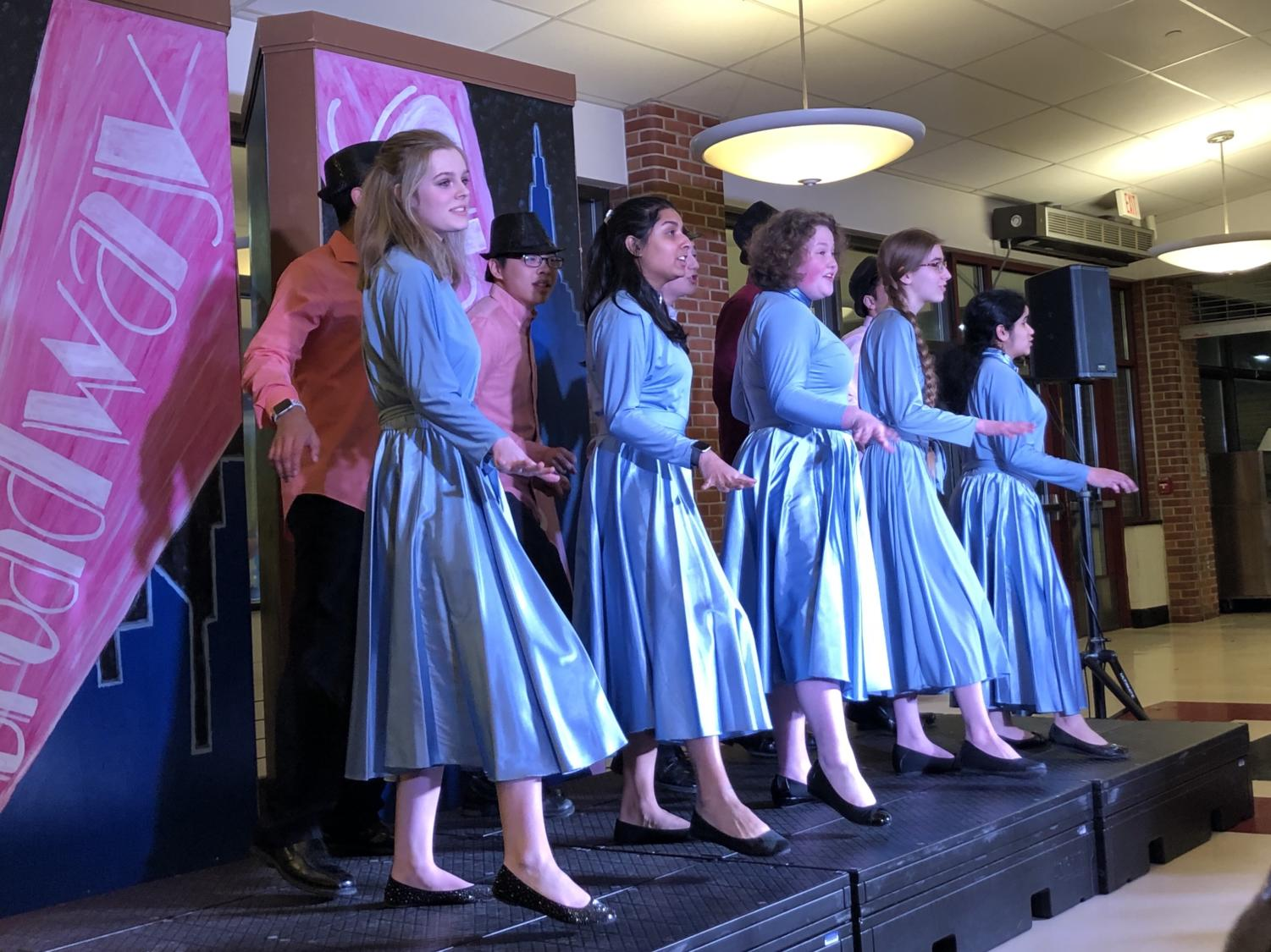 Dancing Divas-- Students sing with an accompanying dance routine during the Broadway Showcase. The showcase took place on February 8 in the school cafeteria.
