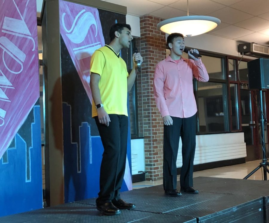 Singing+Seniors--+Seniors+Yash+Sabarad+%28left%29+and+Brian+Peng+%28right%29+sing+a+duet+in+front%0Aof+the+crowd+at+the+Broadway+Showcase.+Groups%2C+duets%2C+and+soloists+performed+during%0Athe+showcase+to+families+and+high+school+faculty+and+staff.